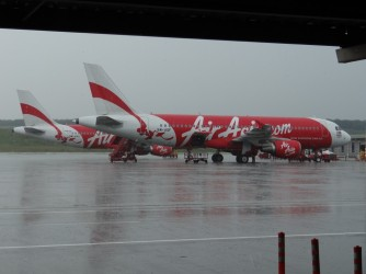26 AirAsia plane under rain